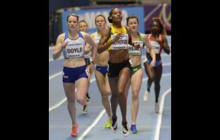 Stephanie McPherson competing in the women's 400m event at the World Athletics Indoor Championships in Birmingham, Britain, Friday, March 2, 2018.