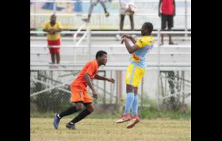 Waterhouse FC's Nicoli Finlayson (right) heads the ball over Tivoli Gardens FC's Stephen Barnett during their Red Stripe Premier League match at the Edward Seaga Sports Complex yesterday.