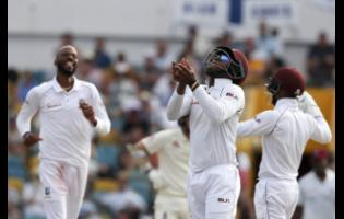 West Indies' Shimron Hetmyer [centre]celebrates after taking the catch to dismiss England's Ben Foakes during day four of the first Test match at the Kensington Oval in Bridgetown, Barbados, on Saturday, January 26, 2019.