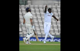 West Indies' captain Jason Holder, right, celebrates the dismissal of England captain Ben Stokes, left, during the second day of the first cricket Test match between England and West Indies, at the Ageas Bowl in Southampton, England, Thursday, July 9, 2020.