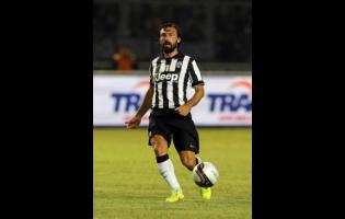 In this August 6, 2014, file photo, Juventus' Andrea Pirlo controls the ball during a friendly match against Indonesia Super League All-Stars at Gelora Bung Karno stadium in Jakarta, Indonesia.