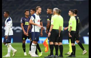 Tottenham's Harry Kane (centre) talks to referees during the English Premier League soccer match between Tottenham and Newcastle at the Tottenham Hotspur Stadium in London, yesterday.
