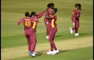 Shamelia Connell celebrates a wicket with teammates against England on Saturday.