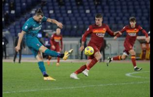 AC Milan's Zlatan Ibrahimovic attempts a shot on goal during the Serie A match against  AS Roma at the Olympic Stadium in Rome, Italy, yesterday.