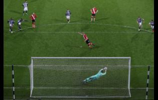 West Bromwich Albion's goalkeeper Sam Johnstone saves a penalty kick from Southampton's James Ward-Prowse during their English Premier League match  at The Hawthorns in West Bromwich, England, yesterday.