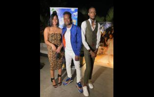 Recording artiste Dilly Chris (centre) is sandwiched by his daughter Dayjanae and son Delano.