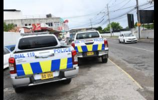 Park Lane, located off Red Hills Road in Kingston, was the scene of a major shooting incident on Saturday. Seven persons were shot, three of them fatally.