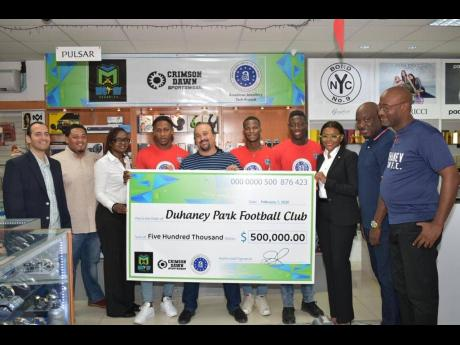 From left:  Raj Khemlani, director, American Jewellery Company Tech Branch; Todd Rhoden, Crimson Dawn; Donna Roache, executive location manager, McKay Security; player Kemar Reid; sponsor Jason McKay, chief executive officer, McKay Security; players Odare Wilson and Shaquan Davis, are joined by Jacqueline Domenico, vice-president, marketing and client services, McKay Security; as well as coach Clareton Walker and manager Darrington Ferguson of Duhaney Park Football Club.