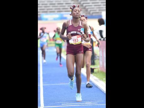 Holmwood Technical High School's Andrene Peart, winner of the Class Three Girls 1500m final.