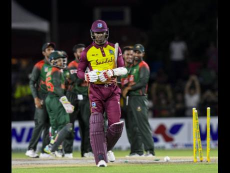 File photo shows Windies batsman Marlon Samuels leaving the pitch after being bowled in the third Twenty20 International against Bangladesh at the Central Broward Regional Park in Lauderhill, Florida, USA. Samuels was charged yesterday for breaching the ICC's anti-corruption code.