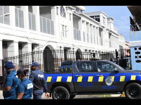 Police outside the Home Circuit Court in downtown Kingston where the alleged members of the Clansman gang are being tried.
